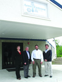 From left, Patricia Titcomb, executive assistant at Aero Fastener; James Avery; Kevin Donovan; and Michael Byrnes outside the new facility.