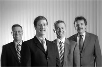 The executive team at Westfield Bank: from left, Leo Sagan, CFO; James Hagan, president and CEO; Allen Miles, executive vice president; and Gerald Ciejka, legal counsel.