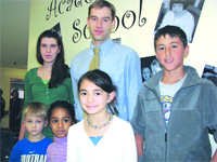 Jake Giessman, or 'Mr. G,' as he's known, with several of his students at Academy Hill. He described 2008 as a breakthrough year for the facility.