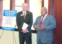 Doug Bowen, left, president and CEO of PeoplesBank, congratulates Henry Thomas III,
