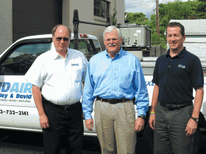 Ward Woodruff (center), with service manager Walter Thayer (left) and Mark Kent