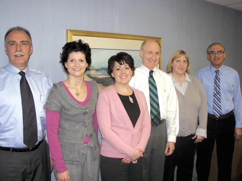 Bob Bolduc, center, with his senior management team
