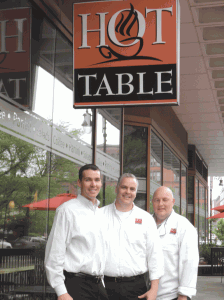 From left, Chris DeVoie, John DeVoie, and Don Watroba say Hot Table was so successful in 16 Acres that they expanded to a second, downtown location, which is also thriving.