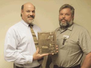 John Lombardi (left, with Assistant Director of Facilities Scott Johnson)