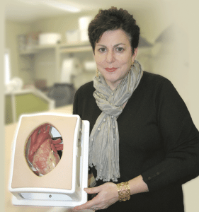 Lisa Chamberlain, seen here with one of the many heart models