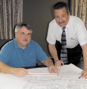 Michael Schafer, left, and Senior Engineer Gregory Henson