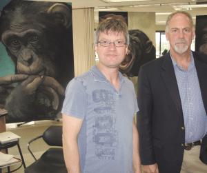 Evan Plotkin, right, with John Simpson