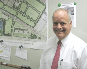 Cory Thurston, seen in front of a map of the new business park