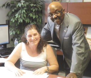 John Murphy Jr., with account administrator Bonnie Moynihan
