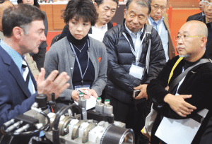 Stephen Scuderi briefs Japanese media about the Scuderi split-cycle engine.