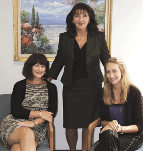 Debra Boronski (center) with two Massachusetts Chamber employees, Heidi Brodeur (left), director of membership services, and Noelle Myers, events and communications manager.