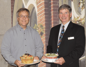 Van Sullivan, left, Retail Dining Services Campus Center manager, and Hotel Manager David O'Connor