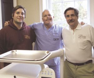 Dr. Kevin Coughlin (center), with Craig Sweitzer (right) and Sweitzer's son, Michael
