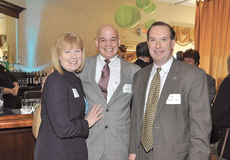 Lynn Ostrowski, director of Brand and Corporate Relations for Health New England, one of the event's sponsors, with Brian Kivel, right, sales executive for Health New England, and Patrick Ireland, president and founder of Neutral Corner Inc.