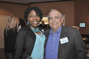 Paula Moore, founder of the Youth Social Educational Training (YSET) Academy and 2014 Difference Maker, networks with Robert Perry, a retired partner of Meyers Brothers Kalicka, P.C. (an event sponsor) and member of the Difference Makers Class of 2011.