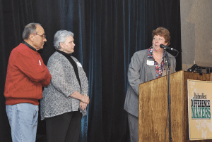 Difference Maker Colleen Loveless, executive director of the Springfield chapter of Rebuilding Together, was recognized this year for her work to help low-income families stay in their homes. Here, she introduces Oscar and Carol Granado, a couple whose home was renovated thanks to the organization.