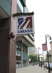 A new sign on the east side of Tower Square announces the arrival of UMass.