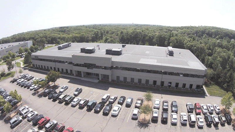 Top: WCA's 62,500-square-foot headquarters in Southwick. Bottom: the company's Milford office, serving Eastern Mass. and Rhode Island.