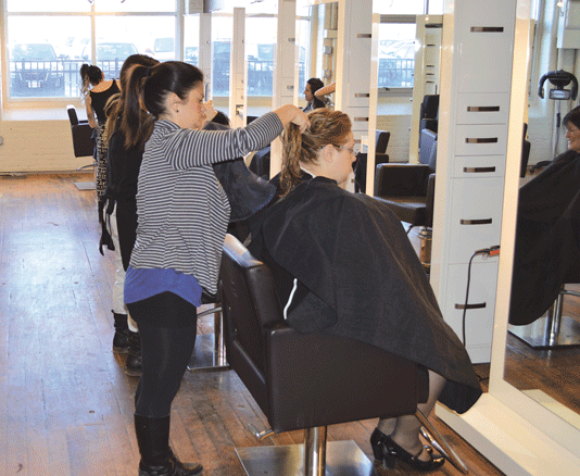 At top, major upgrades and renovations have taken place on every floor at Eastworks. Above, hairdressers are busy at the Lift Salon.
