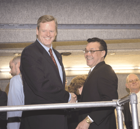 Andy Yee, right, with then Gov.-elect Charlie Baker