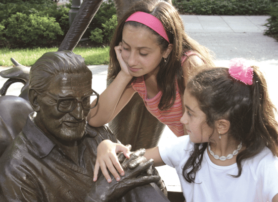 Top: an artist's rendering of one of the scenes to unfold on the first floor of the planned Dr. Seuss museum, set to open in June 2016. Above: kids visit Ted Geisel's statue in the outdoor sculpture garden.