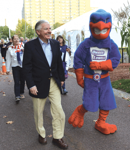 Marty Meehan, seen here with the mascot for UMass Lowell