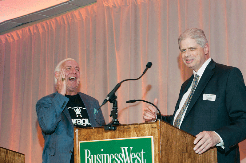 George O'Brien, editor, BusinessWest, shares a laugh with wrestling legend