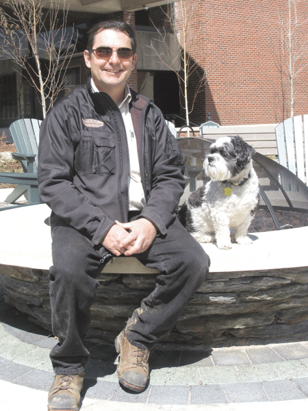 Steve Roberts and his dog, Max