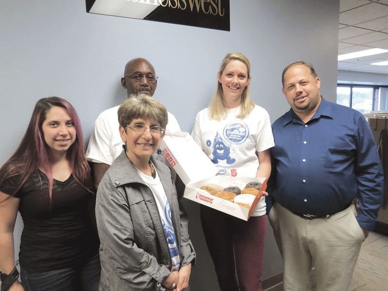 National Donut Day was June 3. The Salvation Army uses that day to bring attention to its programs and encourage contributions to help it carry out its mission. Among the local offices visited by donut-bearing representatives of the Salvation Army was BusinessWest, represented here by senior writer and donut enthusiast Joe Bednar (far right). Representing the Salvation Army are, from left, Laura Stopa, Market Mentors; Elaine Massery, Salvation Army board member; Keith Barrow, Salvation Army staffer, and Amanda Moyer, Market Mentors and Salvation Army board member.