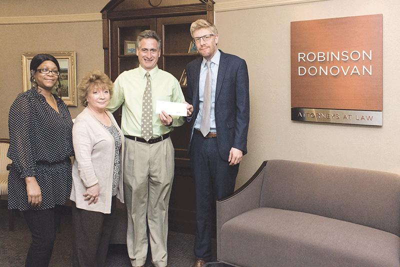 Shawna Cobb, accounts payable/receivable at Robinson Donovan; Kathleen Lamoureux, legal secretary at Robinson Donovan; Andrew Morehouse, executive director at the Food Bank of Western Massachusetts; and Michael Simolo, partner at Robinson Donovan