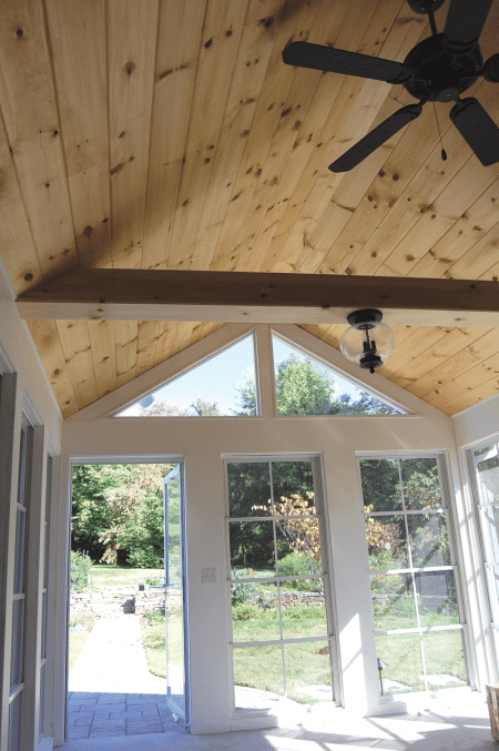 three-season room with a 12-foot knotty-pine ceiling