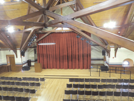 The great room in the Old Chapel before (above), and after.