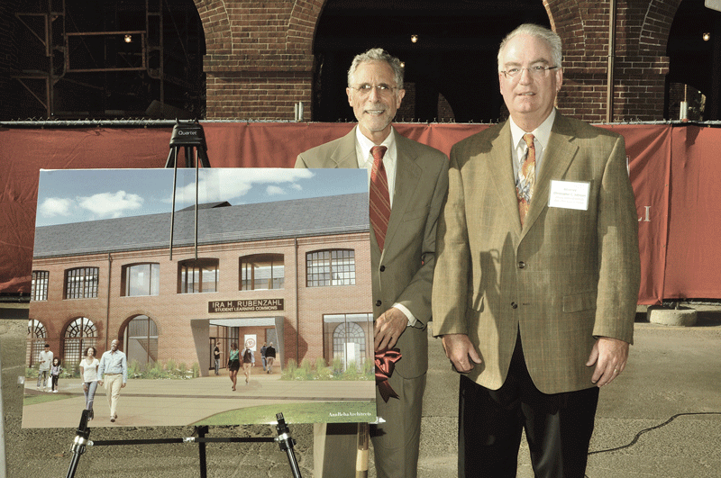 Former STCC President Ira Rubenzahl, left, and Christopher Johnson, STCC board of trustees chairman, stand next to Ann Beha Architects' depiction of the structure that will bear Rubenzahl's name