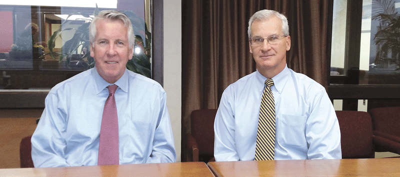 Shareholders Jeffrey Meehan, left, and Barry Ryan