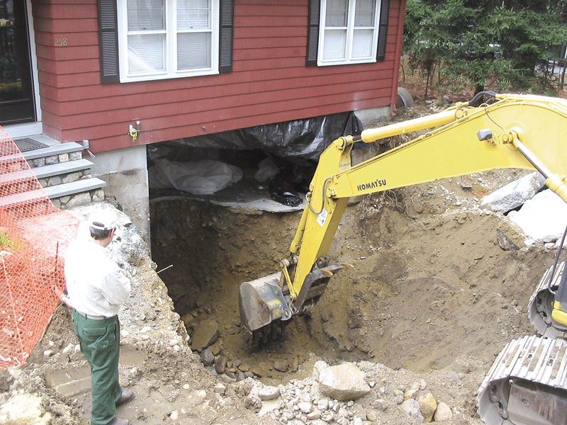 Cleaning the soil after an oil leak at a home