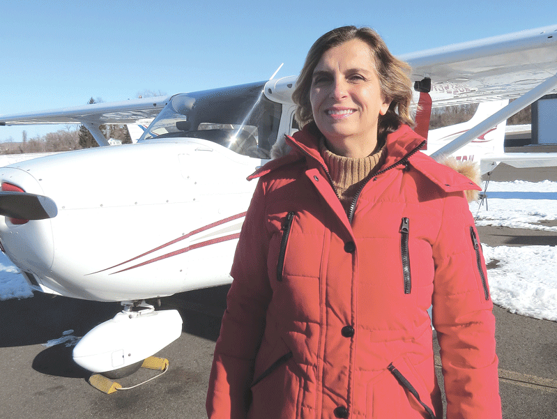 Angela Greco stands by her Cessna 172 SP
