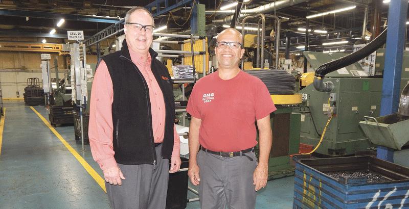Sam Everett and Almeiro Serena say managers walk through the OMG plant