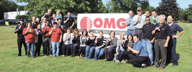 Employees at OMG Roofing Products