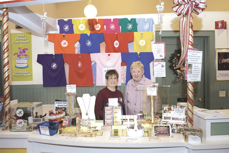 Merry-go-round employee Kathie McDonough, left, staffs the concession stand with long-time volunteer Maureen Costello.