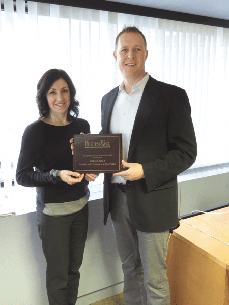 BusinessWest Associate Publisher Kate Campiti presents Paul Kozub with the plaque marking his selection as Top Entrepreneur for 2016.