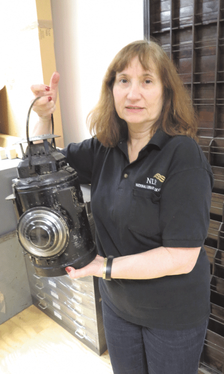 Diane Pikul shows off the train lantern
