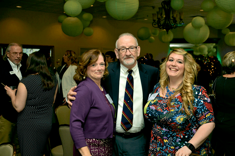 From left, Noni Moran, Dennis Murphy, and Amber Letendre of event sponsor First American Insurance.