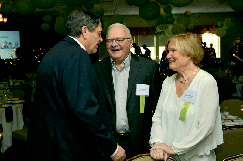 Joe Marois of Marois Construction (left) chats with Ed Murphy and Molly Murphy of event sponsor First American Insurance.