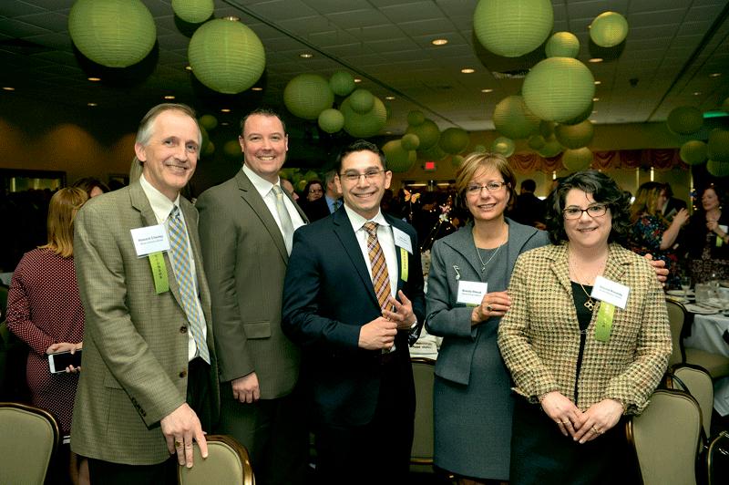 From event sponsor Meyers Brothers Kalicka, P.C., from left, Howard Cheney, James Krupienski, John Veit, Brenda Olesuk, and Donna Roundy.