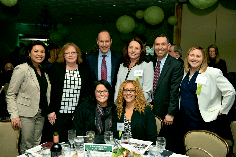 Top row, from left: Glenda DeBarge of event sponsor Health New England (HNE); Jen Stone of USI Insurance Services; Mark Keroack of Baystate Health; Ashley Allen, Jody Gross, and Jessica Dupont of HNE. Bottom row: Michelle Martone of USI (left) and Yvonne Diaz of HNE.