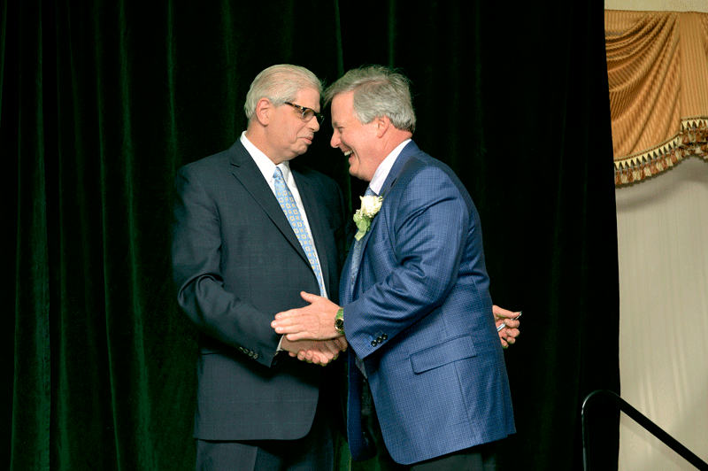 BusinessWest Editor George O'Brien congratulates 2017 Difference Maker Denis Gagnon Sr., president and CEO of Excel Dryer.