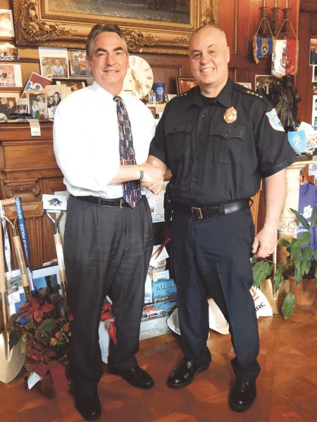 Springfield Mayor Domenic Sarno (left) and Police Commissioner John Barbieri