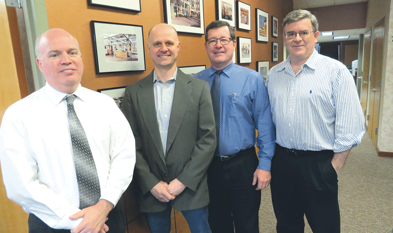 From left, the principals at Caolo & Bieniek Associates, James Hanifan, Bert Gardner, Curtis Edgin, and John MacMillan.