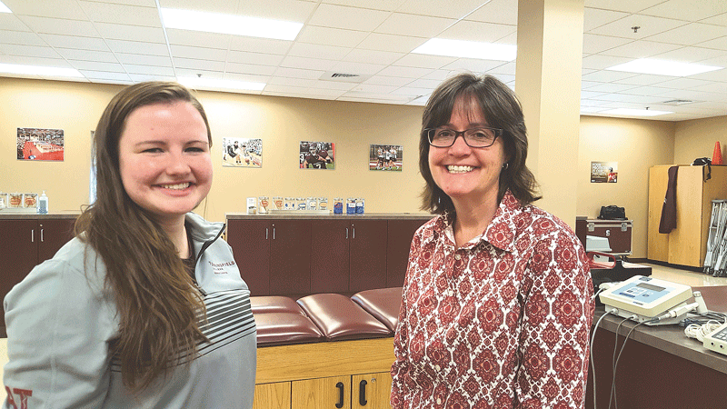 Tori Bouchard, certified trainer and 2017 Springfield College graduate (left), with Sue Guyer, chair of Exercise Science and Sport Studies at the college.