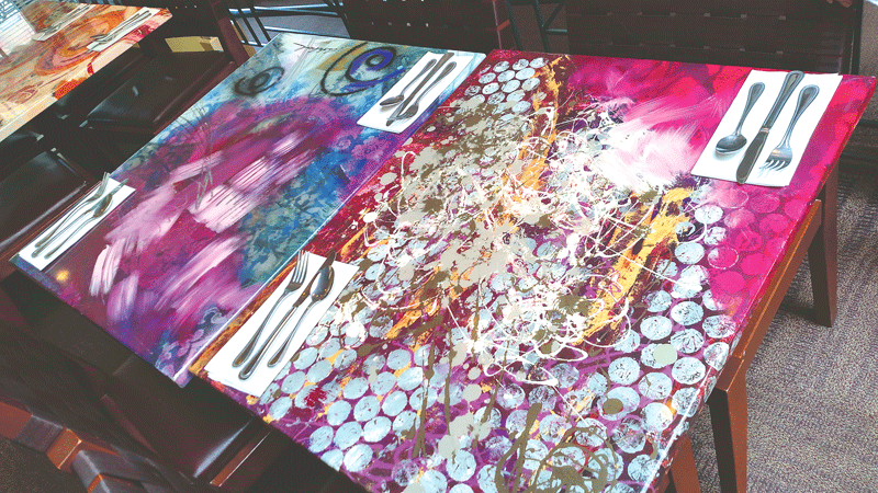 Donna Estabrooks' wildly colorful tabletops have become a hallmark of Judie's.